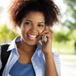 Stock Photo: Female Student Answering Mobilephone On Campus