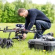 Engineer Setting Camera On UAV Helicopter — Stock Photo
