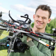 Stock Photo: Technician Holding UAV Octocopter
