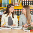 Women Looking At Each Other While Studying In Library — Stock Photo #33735725