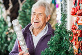 Man Holding Bauble Packet In Store — Stock Photo