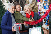 Family Taking Selfportrait At Christmas Store — Stock Photo