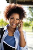 Female Student Answering Mobilephone On Campus — Stock Photo