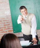 Student Pointing At Student In Classroom — Stock Photo