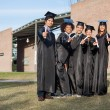 College Students Showing Diplomas Standing On Campus — Stock Photo #33747627