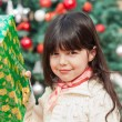 Girl Holding Christmas Present — Stock Photo