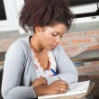 Student Writing Exam At Desk In Classroom — Stock Photo