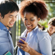 Friends Reading Text Message On Cellphone In Campus — Stock Photo