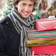 Happy Man Carrying Stacked Gift Boxes — Stock Photo