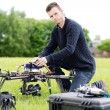 Stock Photo: Young Engineer Preparing Spy Drone in Park