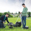 Technicians Working On UAV Spy Drone — Stock Photo