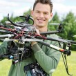 Young Engineer Holding UAV Helicopter — Stock Photo