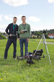 Engineers Holding Remote Controls Of UAV — Stock Photo