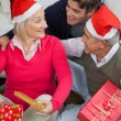 Son With Parents Holding Christmas Presents — Stock Photo