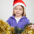 Girl Looking At Tinsels During Christmas — Stock Photo #33780775