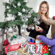 Mother And Siblings Decorating Christmas Tree — Stock Photo #33781047