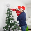 Son And Father Decorating Christmas Tree — Stock Photo