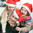 Father Piggybacking Children During Christmas — Stock Photo