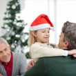 Girl Embracing Father During Christmas — Stock Photo