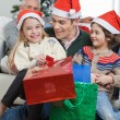 Siblings And Father With Christmas Presents — Stock Photo #33782083