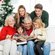 Family Reading Book Together In House — Stock Photo #33782245
