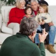 Man Photographing Family Through Smartphone — Stock Photo