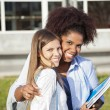 WomStanding With Arm Around Friend On Campus — Stock Photo #33783429