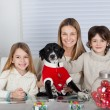 Happy Family With Pet Dog During Christmas — Stockfoto