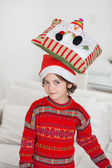 Boy Balancing Cushion On Head During Christmas — Stock Photo