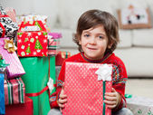 Cute Boy With Holding Christmas Present — Stock Photo