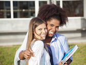 Woman Standing With Arm Around Friend On Campus — Stock Photo