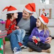 Loving Father With Siblings During Christmas — Stock Photo