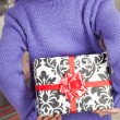 Stock fotografie: Girl Hiding Christmas Gift Behind Back
