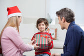 Boy Taking Christmas Present From Mother — Stock Photo