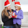 Surprised Mother And Daughter With Christmas Gift — Stock Photo