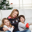 Stock Photo: Mother And Children At Home During Christmas