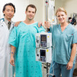 Patient With Doctor And Nurse Standing By Machine Stand — Stock Photo