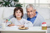 Grandfather And Son With Envelope — Stock Photo