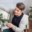 Man Decorating Christmas Tree — Stock Photo