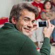 Father Photographing Family Through Smartphone — Stock Photo