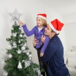 Daughter And Father Decorating Christmas Tree — Stok fotoğraf