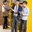 Librarian And Student Reading Book In Library — Stock Photo