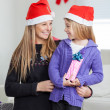 Mother And Daughter With Christmas Present — Stock Photo