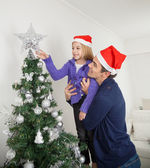 Daughter And Father Decorating Christmas Tree — Stock Photo