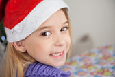 Happy Girl Wearing Santa Hat — Stock Photo