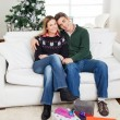 Stock fotografie: Couple With Christmas Presents On Floor