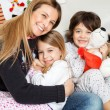 Loving Mother With Children During Christmas — Stock Photo