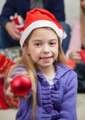 Smiling Girl Showing Christmas Ornament — Stock Photo