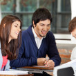 Students Discussing Over Book In Classroom — Stock Photo