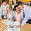 Teachers And Students Discussing Over Book In Library — Stock Photo